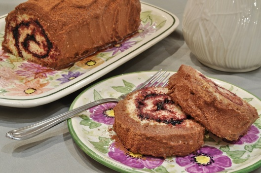 Elderberry Jam Rouladee with Maple-Chocolate Frosting