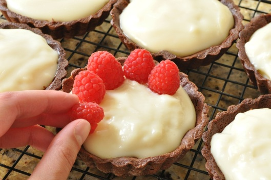 Place Raspberries on the Chocolate-Cointreau Tarts