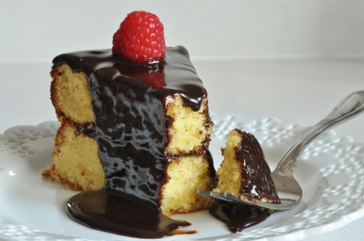 White Chocolate Butter Cake with Hot Fudge Glaze and Raspberries